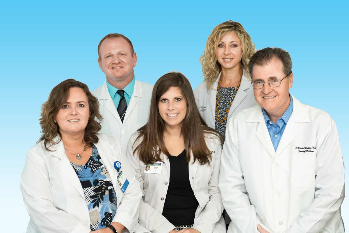Group photo of Helton Family Medicine doctors in blue background
